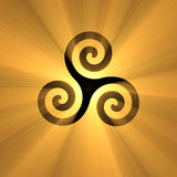 Spiral symbol Triskelion with light flare Royalty Free Stock Photo