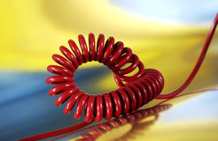 Spiral telephone cable. Red telephone cable on colored background Stock Photo