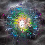 Spiral of time and energy explode from man Stock Photo
