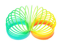 Spiral Toy On White Background Half Uncoiled Stock Photography