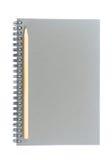Spiral tråd som är destinerad eller - den destinerade sketchbooken som gjordes från grå färgbräde och träblyertspennan, isolerade Royaltyfri Fotografi
