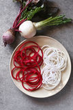 Spiral turnip and beetroot spaghetti imitation noodles on a plate Stock Images