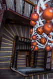 Spiral view of round stairs looking down with Christmas decoration Royalty Free Stock Photo
