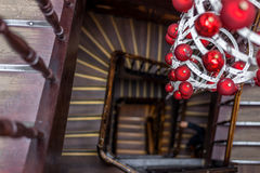 Spiral view of round stairs looking down with Christmas decoration Stock Photo