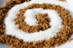 Spiral with white and brown sugar Royalty Free Stock Photo