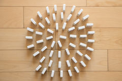 Spiral of White Dominoes Stock Photo
