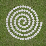 Spiral of white stone on grass. Spiral of stones on grass Stock Image