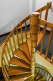 Spiral wooden staircase with varnished balusters Stock Image