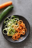 Spiral zucchini and carrot spaghetti imitation noodles. On a plate.Top view Royalty Free Stock Image