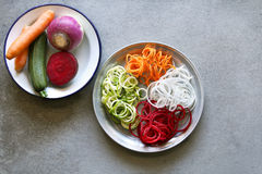 Spiral zucchini,carrot,turnip and beetroot spaghetti imitation noodles on a plate Royalty Free Stock Photos