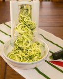 Spiral Zucchini zoodles noodles in spiralizer Royalty Free Stock Image