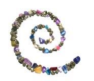 Spirala złociste błyszczące skały i klejnoty, tworzy symbol obraz royalty free