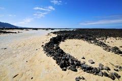 Spirale bianca della spiaggia della collina della spagna della gente delle rocce nere nella lan Fotografia Stock
