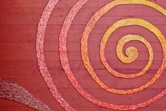 Spirale de mosaïque sur le mur Photographie stock