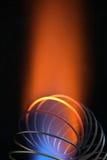 Spirale del metallo in fiamma Fotografie Stock