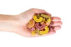Spirale della pasta a disposizione isolata su fondo bianco Fotografia Stock Libera da Diritti