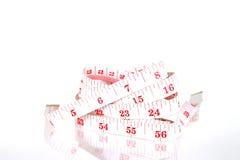 Spirale di misurazione del nastro dell'abbigliamento Immagine Stock