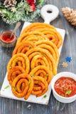 Spirales de la pomme de terre et du fromage en huile Photographie stock libre de droits