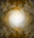 Spiraling golden white light vortex background Royalty Free Stock Images