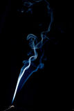 Spiraling smoke abstract on black Royalty Free Stock Photo