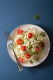 Spiralized courgette salad with avocado dressing, healthy vegan Stock Photo