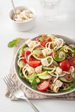 Spiralized courgette salad greek style with tomato feta olives c Stock Image