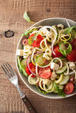 Spiralized courgette salad greek style with tomato feta olives c Royalty Free Stock Image