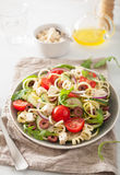 Spiralized courgette salad greek style with tomato feta olives c Royalty Free Stock Photo