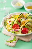 Spiralized courgette salad with sweetcorn tomato avocado, health Stock Image