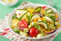 Spiralized courgette salad with sweetcorn tomato avocado, health Royalty Free Stock Photos