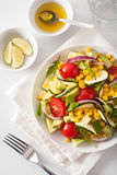 Spiralized courgette salad with sweetcorn tomato avocado, health Stock Photography