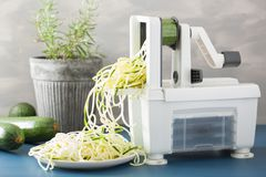 Spiralizing courgette raw vegetable with spiralizer stock photos