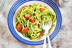Spiralled courgette with green pesto and cherry tomatoes. Spiralled courgette spaghetti with green pesto and cherry tomatoes Royalty Free Stock Photos