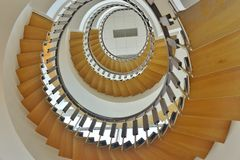 Spiralling stairs up to the fourth floor Royalty Free Stock Images