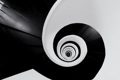 Spiralling stairway black and white stock image