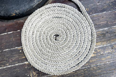 Spirally arranged, the rope on the deck of an old yacht. Stock Photo