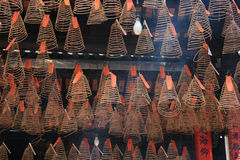 Spirals of incense are hung to the ceiling of a temple (Vietnam) Stock Photo
