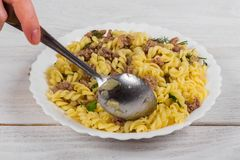 Spirals pasta with minced meat on a white plate on a wooden background. Italian food royalty free stock photography