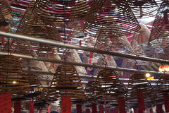 Spirals in a temple in Hong Kong. Burning spirals in a temple in Hong Kong stock image