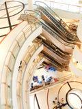 Spiraltrappuppgång och rulltrappa. Royaltyfri Foto