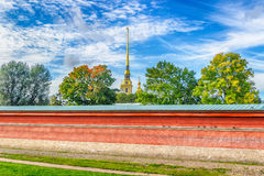 Spire  bell tower  Peter and Paul Cathedral  fortress wall St.-P Stock Photo
