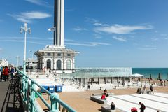 Spire of British Airways i360 observation tower in Brighton, gull in the rays. Brighton, United Kingdom - AUGUST 1, 2017: Spire and flag and ticket office Stock Image