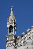 Spire of the Cathedral in Monza. A spire of the cathedral in Monza (IT) against a blue sky Stock Images