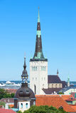 The spire of the Church of St. Olaf. Old Tallinn, Estonia. The spire of the Church of St. Olaf close up against the blue sky. Old Tallinn, Estonia Stock Image