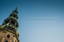 Spire of clock tower Saint Peter church, Riga, Latvia royalty free stock photos