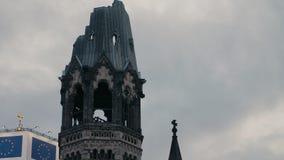 Spire of the Kaiser Wilhelm Memorial Church Gedächtniskirche in Berlin in 4K stock video footage