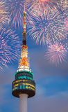 The spire of N Seoul Tower with Fireworks Stock Photo