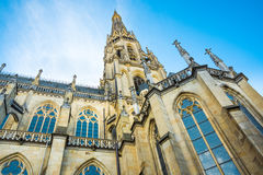 Spire of the New Dome gothic cathedral in Linz, low angle view, blue sky, close up of architectural details Royalty Free Stock Photography