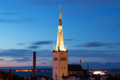 The spire of the  Oleviste church against the background of the twilight sky. Old Tallinn, Estonia Royalty Free Stock Photo