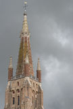 Spire of Onze-Lieve-Vrouw Cathedral in Bruges. Stock Photo